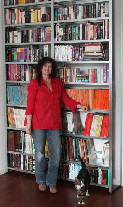 Collectorz.com's leading lady Sytske Hermans and her home library